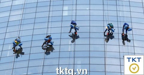 Photo: Cleaning service of high-rise glass buildings of office buildings