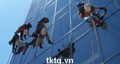 Photo: cleaning service of high-rise glass using rope