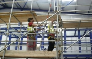 Factory spider web cleaning using scaffolding